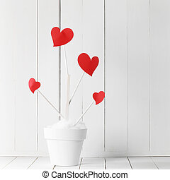 Love tree in flower pot - Love tree with red heart shaped ...