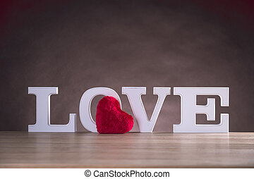 Love valentine concept with white letters