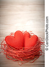 Love, Valentines Day. Hearts handmade on wood. Couple in nest