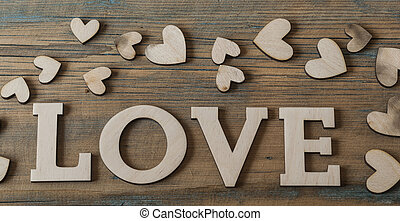 Love wooden letters on rustic background