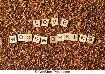 Love woodworking word writen with letters on a wood chips