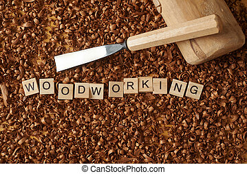 Love woodworking word writen with letters on wood chips with a chisel and mallet