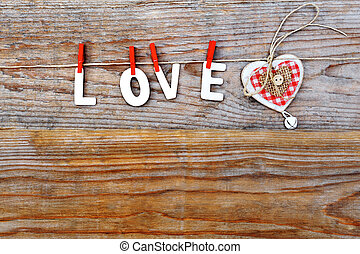love word and heart on wooden background