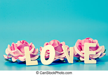 LOVE word and pink rose.