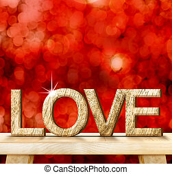 LOVE word in wood texture on wooden table with red bokeh background, Valentine concept, Template that leave space for your content