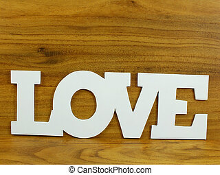 love word with wooden background