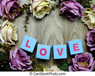 love word wooden block with artificial roses flowers decor