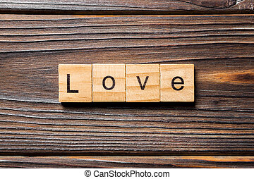 love word written on wood block. love text on table, concept