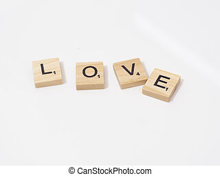 Love word written with wooden blocks isolated