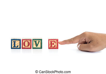 """LOVE"" write in colorful wood alphabet blocks and hand holding ""E"" isolated on white"