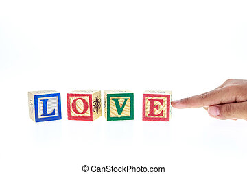 LOVE written in colorful alphabet blocks isolated on white