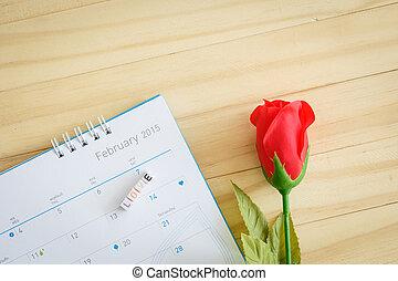LOVE written in letter beads on calendar