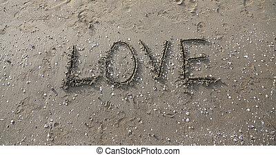 LOVE written on the beach sand