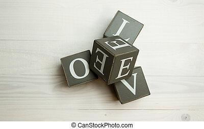 Love written wooden blocks. Concept of building love