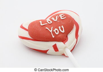 candy lolly with love you written on a red heart