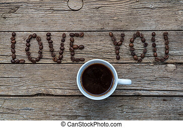 LOVE YOU coffee beans on wooden background