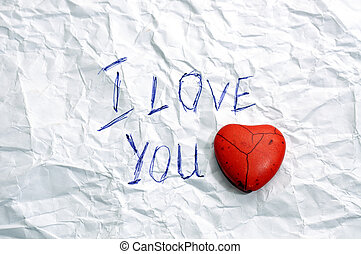 Love You - message I Love You on wrinkled paper and red...