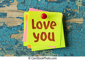 LOVE YOU text written on sticky note