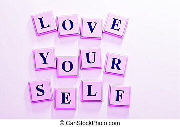 Love Yourself spelled out in colored blocks