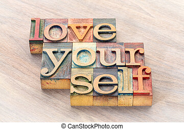 love yourself word abstract in letterprtess wood type blocks stained by color inks