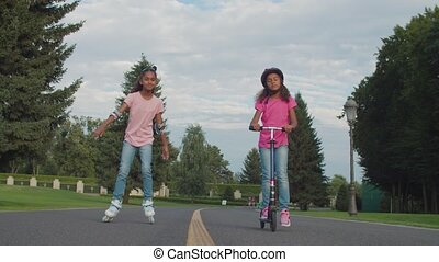 Lovely active sisters enjoying leisure in park - Lovely ...