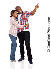 african american couple pointing