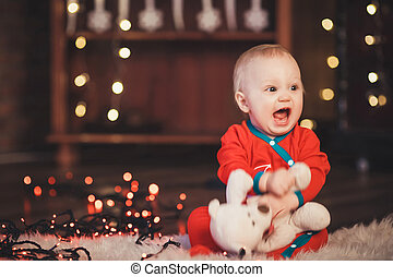 Lovely Baby boy in Santa Claus costume