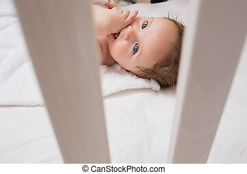 Lovely baby with finger in mouth
