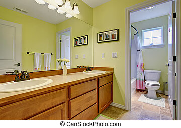Lovely bathroom with green walls.