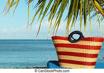 lovely beach bag on sun lounge