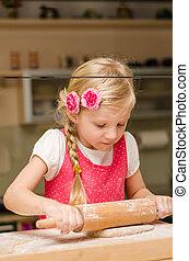 lovely blond girl baking