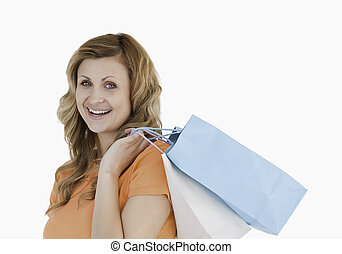 Lovely blond-haired woman showing her shopping