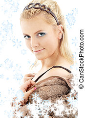 lovely blond in fur jacket with showflakes