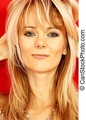 lovely blond over red - portrait of lovely smiling lady over...