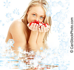 blond with rose petals and snowflakes in water