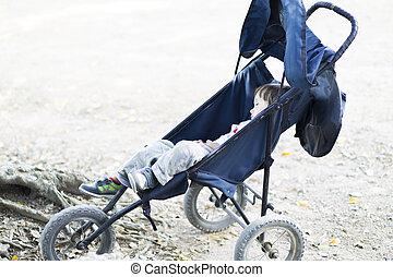 Lovely Boy Sleeping in  Baby Stroller