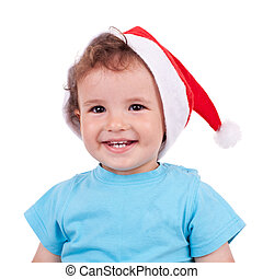 Lovely boy with a christmas cap and smiling