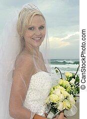 Lovely Bride Under Veil at the Beach