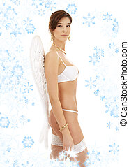 brunette in white lingerie with angel wings and snowflakes