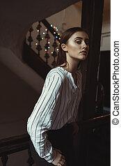 Lovely brunette model posing at the passage