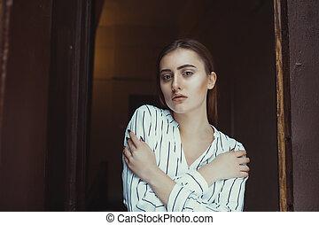 Lovely brunette model posing in the dark room