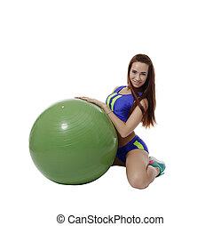Lovely brunette posing with fitness ball