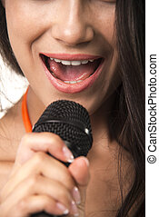 Impassioned lady in orange shirt with microphone.