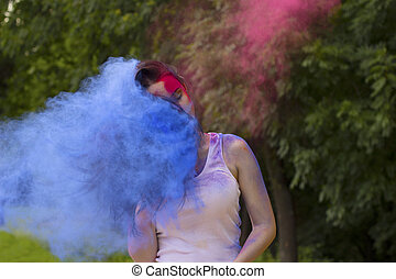 Lovely brunette woman with hair in motion and dry paint