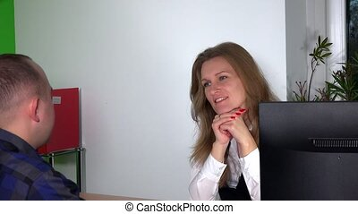 Lovely business woman talking with her colleague at office