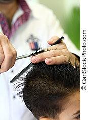Lovely child at hairdresser