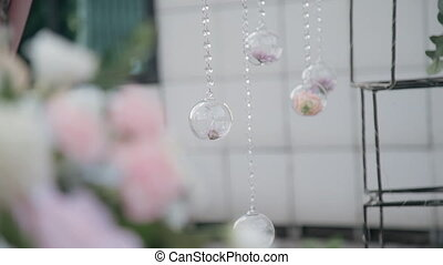 Lovely composition of flowers in glass balls capture...