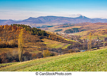 lovely countryside in autumn. village in the nearest...