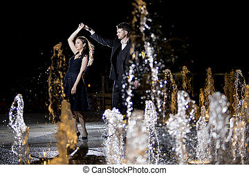 Lovely Couple at a Fountain at Night