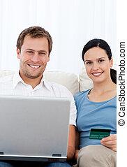 Lovely couple buying onllne